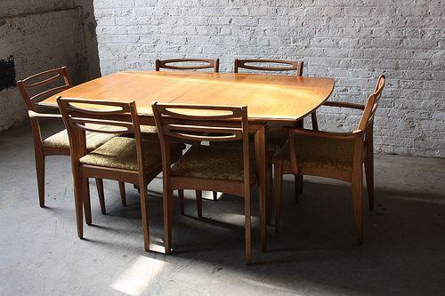 Intriguing Mid Century Modern Cat Eye Walnut Dining Set 1960 s