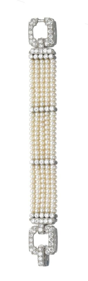 NATURAL PEARL AND DIAMOND BRACELET, CARTIER, 1920s.  Designed as five rows of natural and cultured pearls  to a clasp of geometric design by Hanis Panache