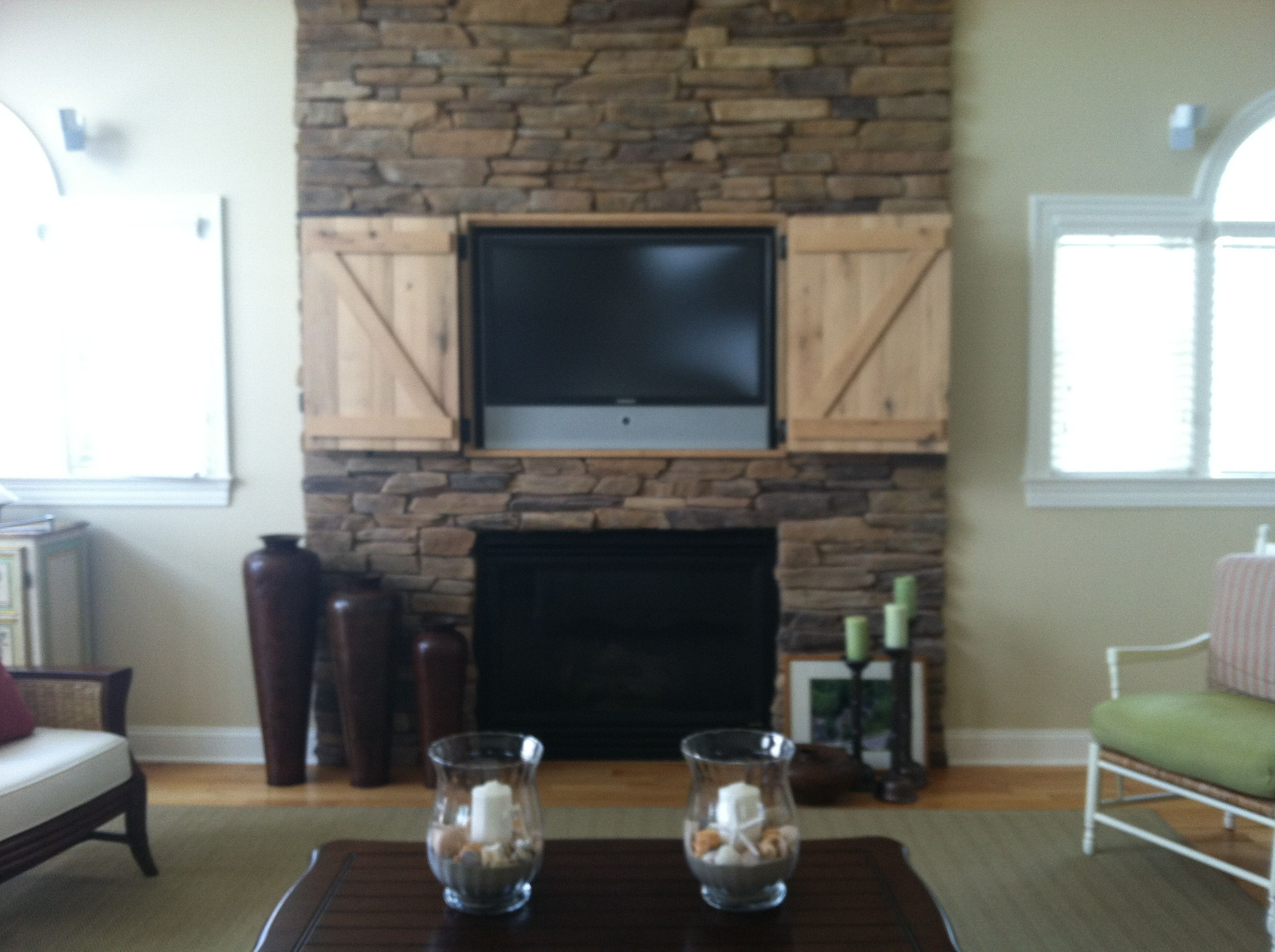 Hidden tv over fireplace open doors decor and design - Ideas to cover fireplace opening ...