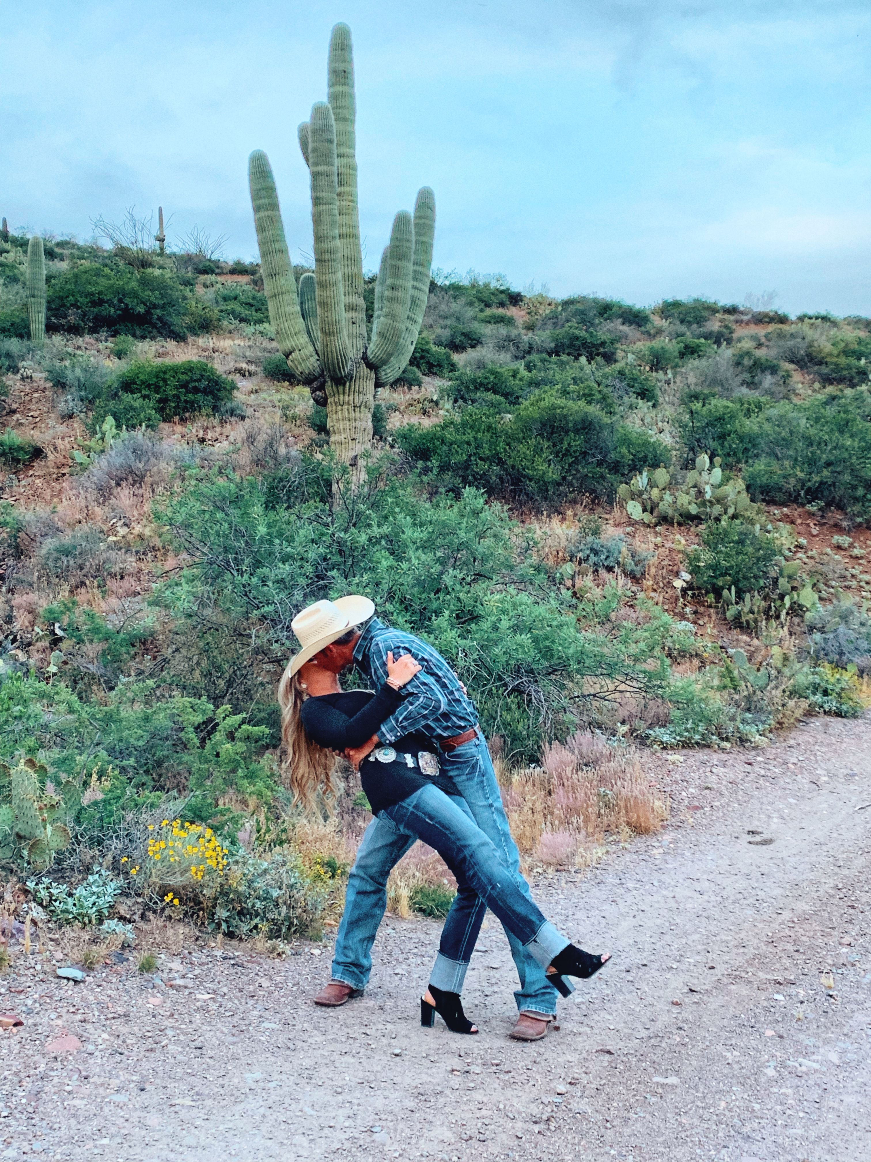 Cowboy And Cowgirl In The Arizona Desert
