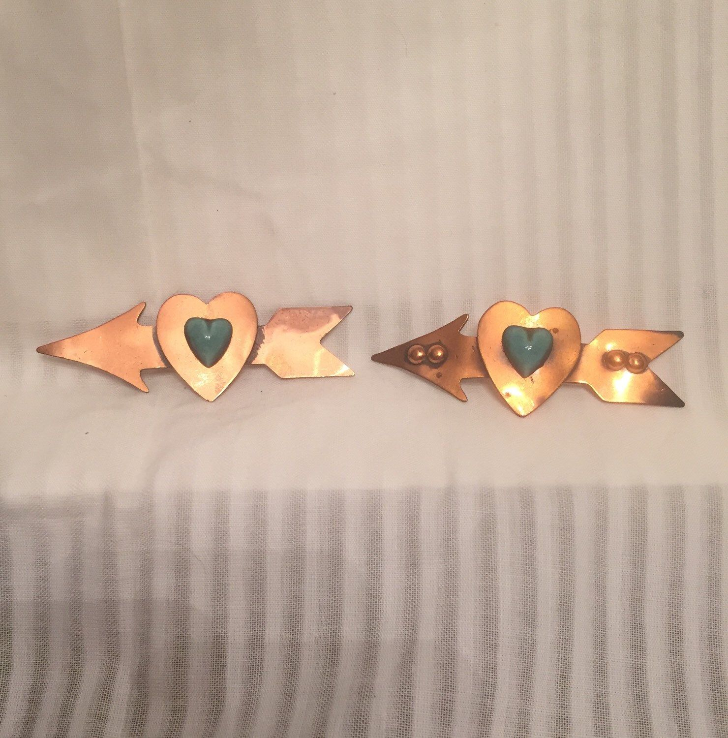 A personal favorite from my Etsy shop https://www.etsy.com/listing/226143186/copper-arrow-and-jade-ceramic-heart-two