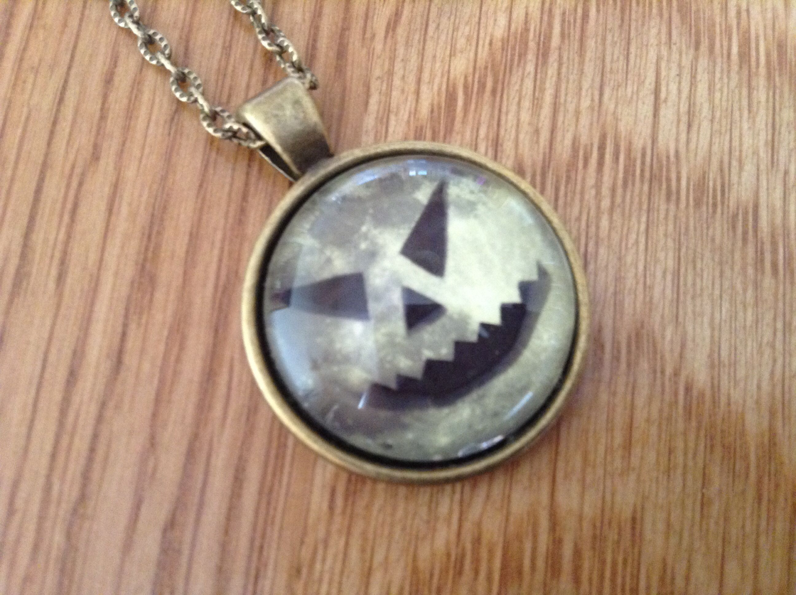 Available on www.shiverywicks.ie Halloween Scary Pumpkin Face pendant