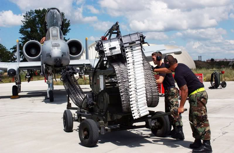 Loading the 30mm main gun in an A-10 Thunderbolt. Booya!