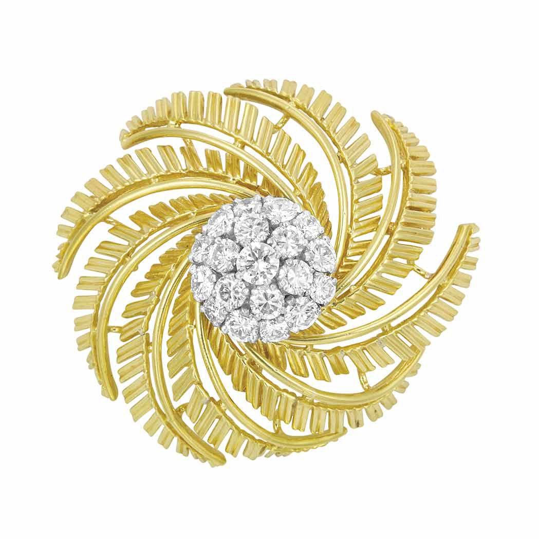 Gold, Platinum and Diamond Brooch, Cartier, France   18 kt., designed as a spiral of overlapping gold leaves, centering a cluster of 19 round diamonds approximately 2.30 cts., signed Cartier Inc., Made in France, approximately 14 dwts.