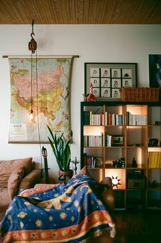 I like the use of the bookshelf as a light source. And those single light strands are cool, especially with the old maritime pulley.
