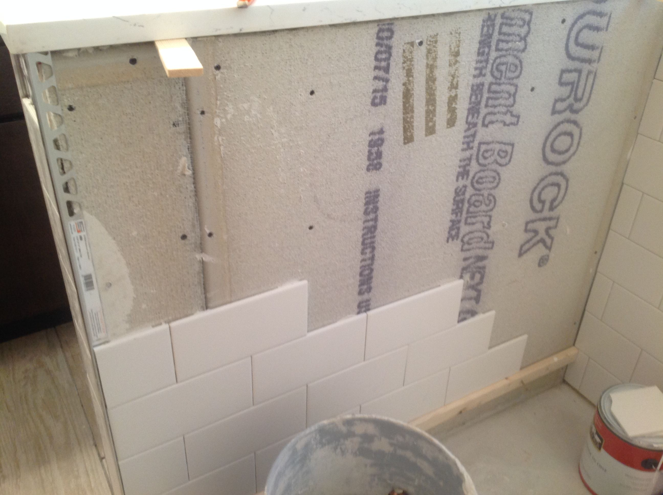 In progress subway tile s installed in a shower over Durock during a plete bathroom remodel in Chicago