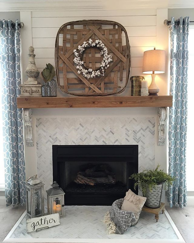 Remodeled fireplace Shiplap wood mantle herringbone tile