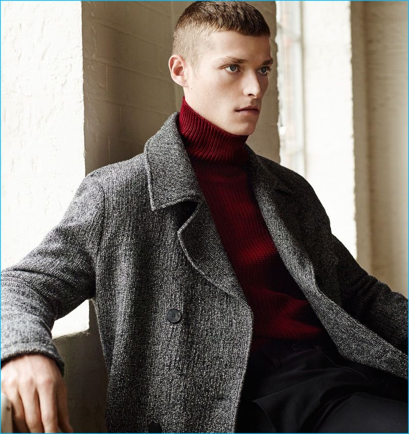 3ac76168 Julius Gerhardt is a chic vision in a Zara Man double-breasted coat with a red  turtleneck sweater and trousers.