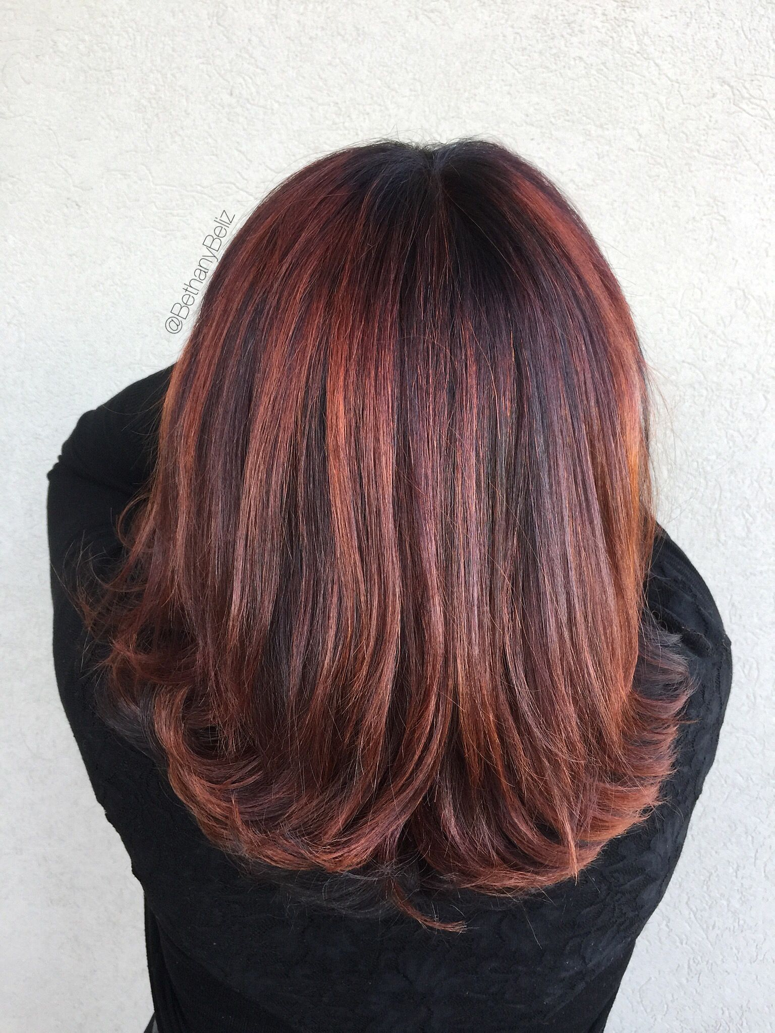 Color and copper balayage with heavy texturizing on a layered lob