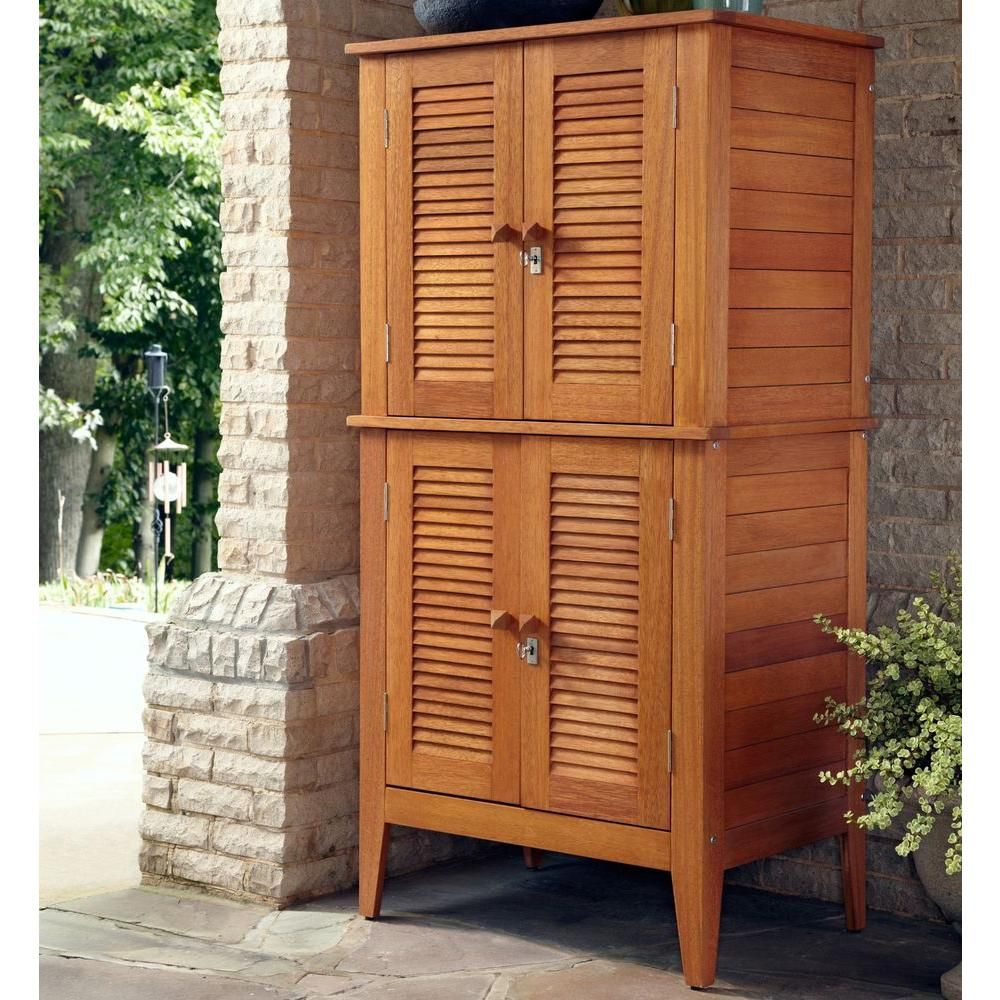 Home Styles 22 In X 32 In X 64 5 In Montego Bay Four Door Multi Purpose Storage Cabinet 5661 27 The Home Depot Patio Storage Outdoor Storage Cabinet Outdoor Deck Storage Box