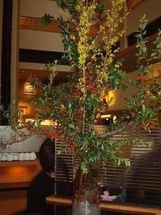 A tall vase of forsythia branches.  To view our entire selection please visit us at www.starflor.com #flowers #events #eventdecor