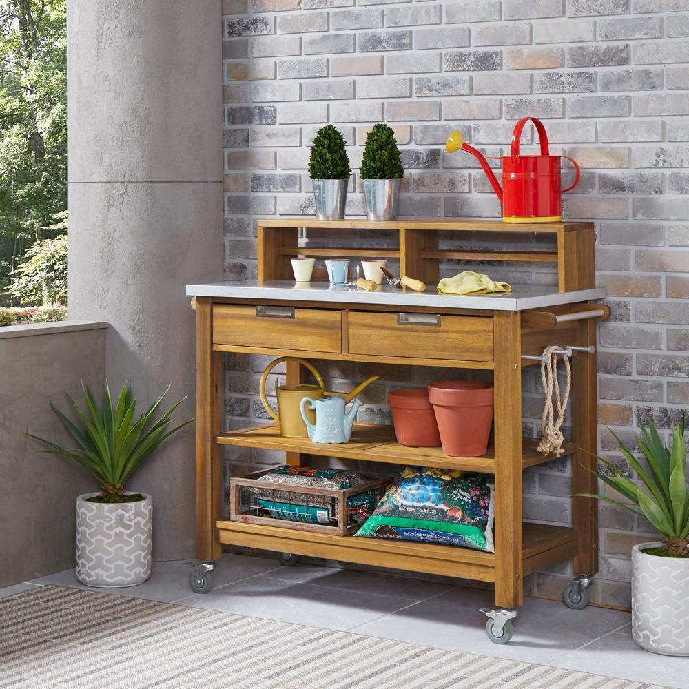 Homestyles Maho Golden Brown Teak Outdoor Potting Cart Serving Bar 5663 91 The Home Depot In 2020 Outdoor Bar Teak Outdoor Bar Serving Cart