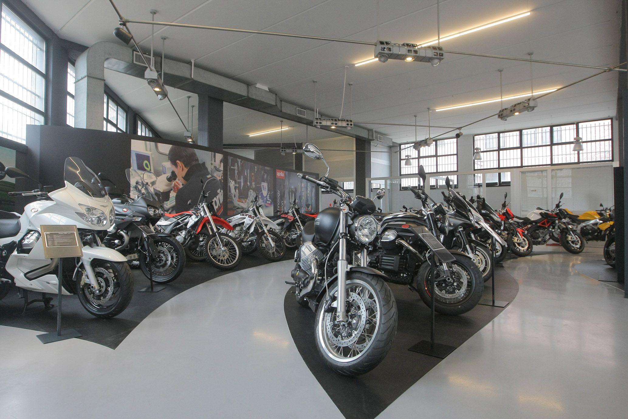 Moto Guzzi along with Aprilia motorbikes in the new Pogliani Store Moto Guzzi motorbike motorcycle store Bike Pinterest