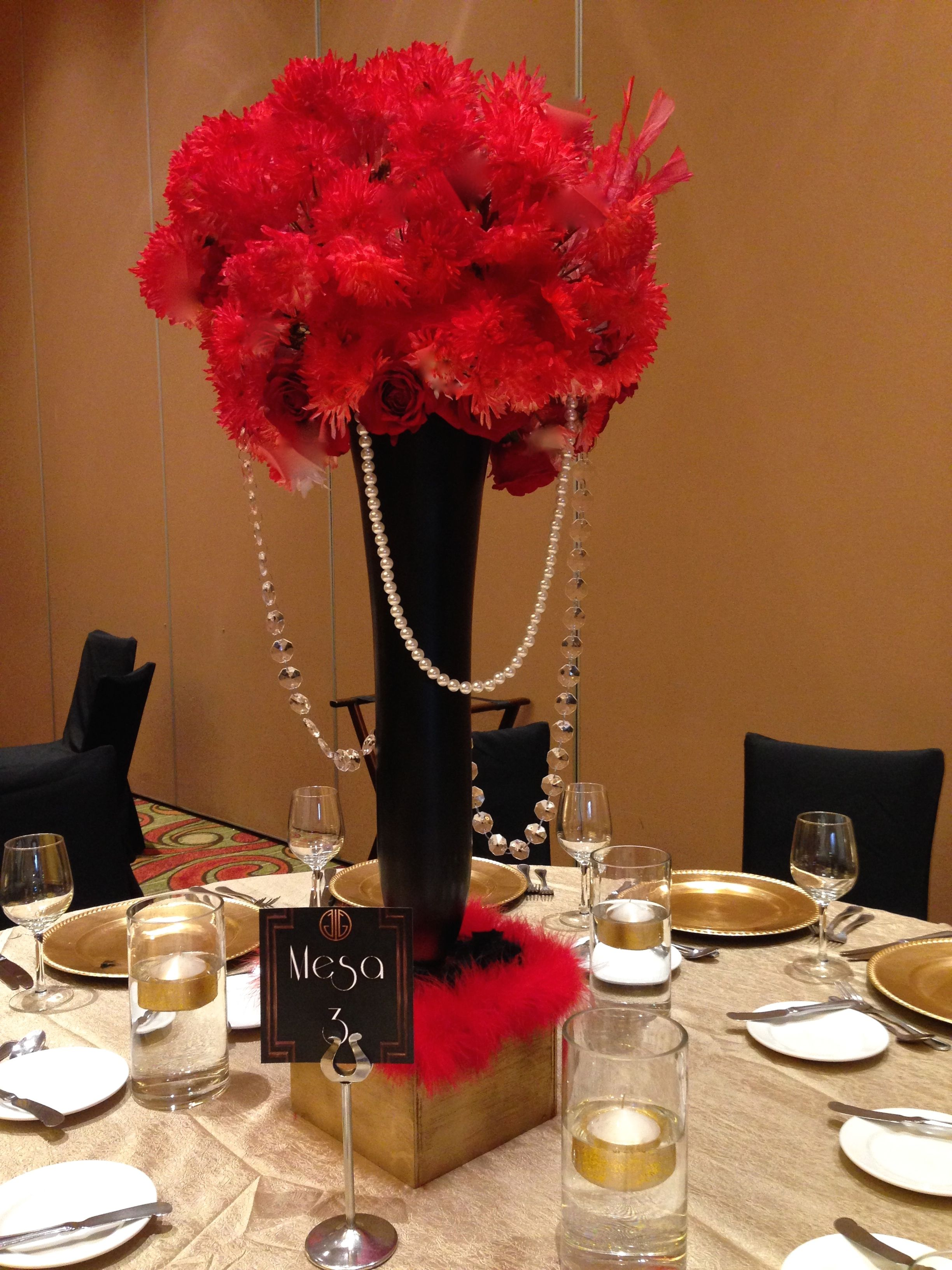 Tall centerpiece red roses and black vases great gatsby