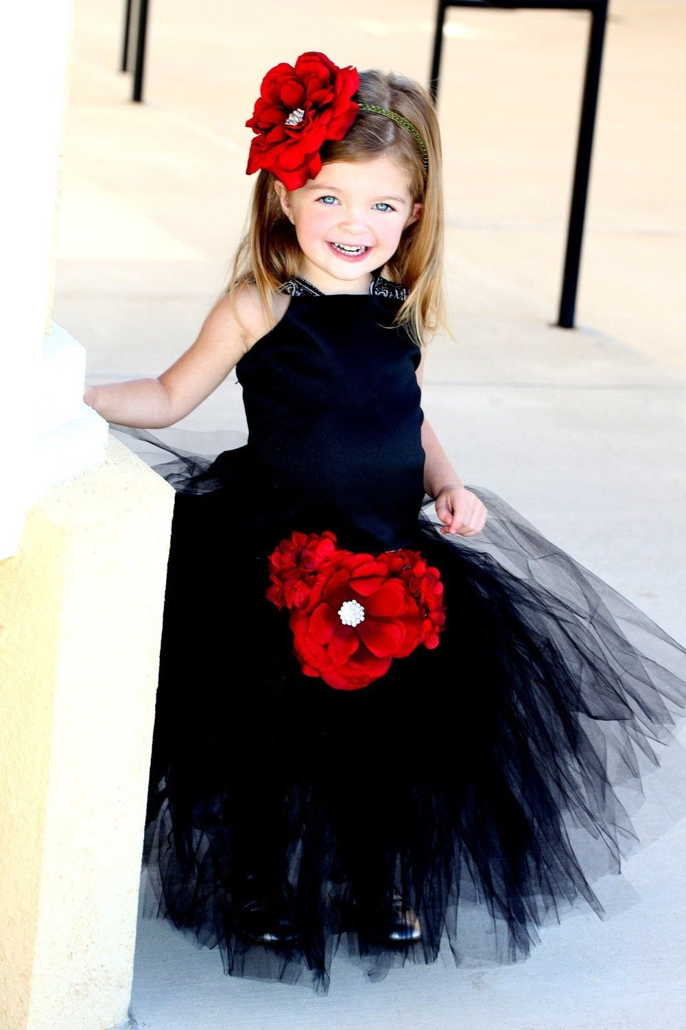Flower girl dress with lace straps for a wedding