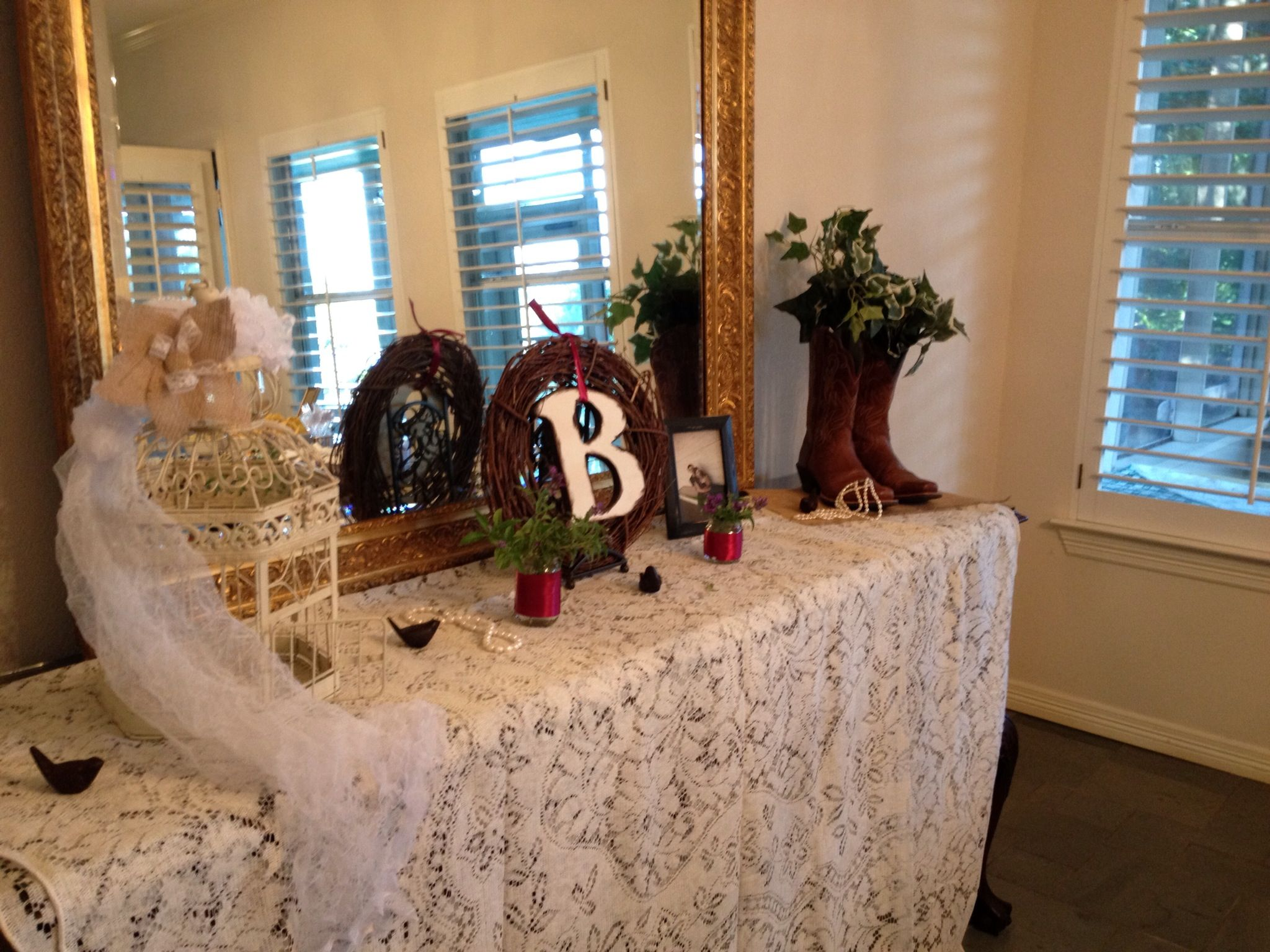 Country themed shower. Burlap, pearls, lace, birds and cowboy boots