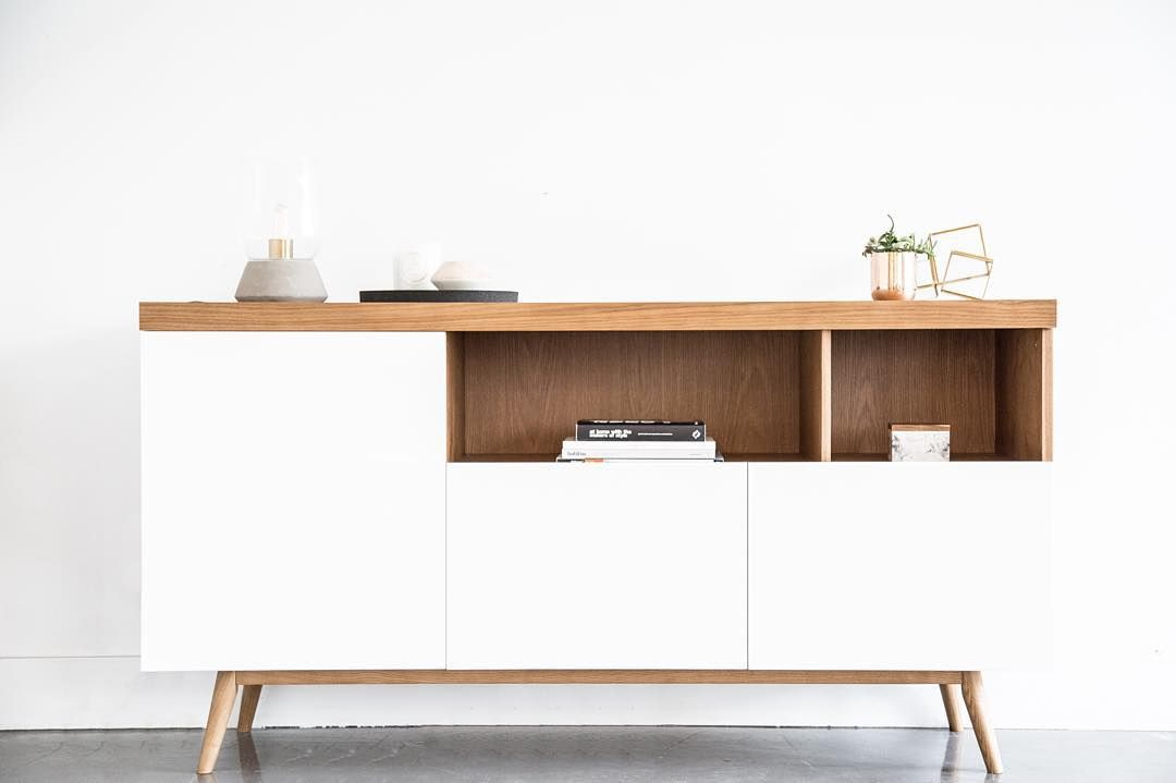 Enjoy the aesthetic beauty of tapered legs crafted from solid American Oak, and cool high-gloss lacquer cupboards made special for this modern Scandinavian sideboard from Kure  #Andrej #sideboard #Kure #DanishDesign #NordicDesign