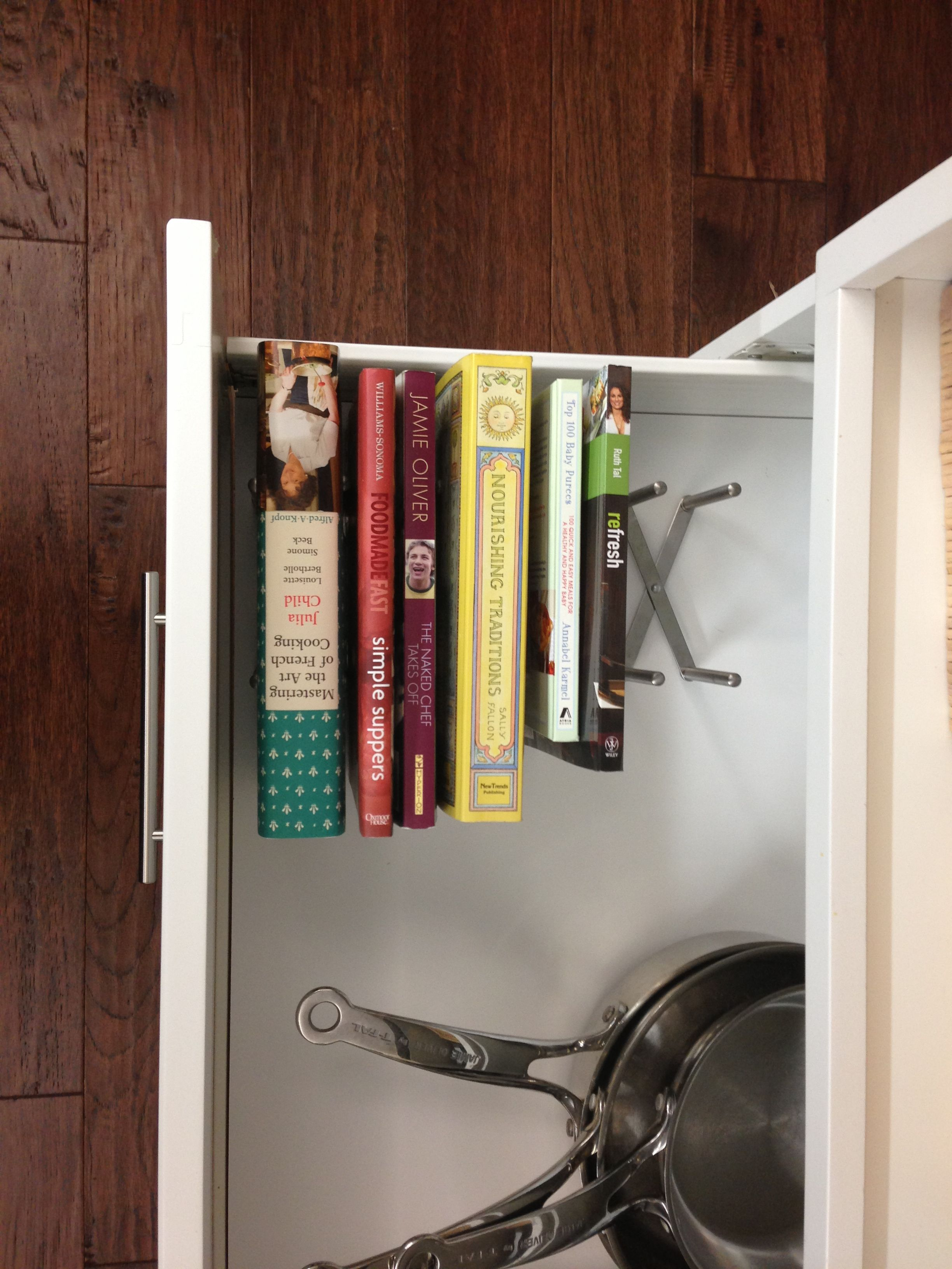 Cookbooks in a pots and pans drawer using an ikea VARIERA pot kid