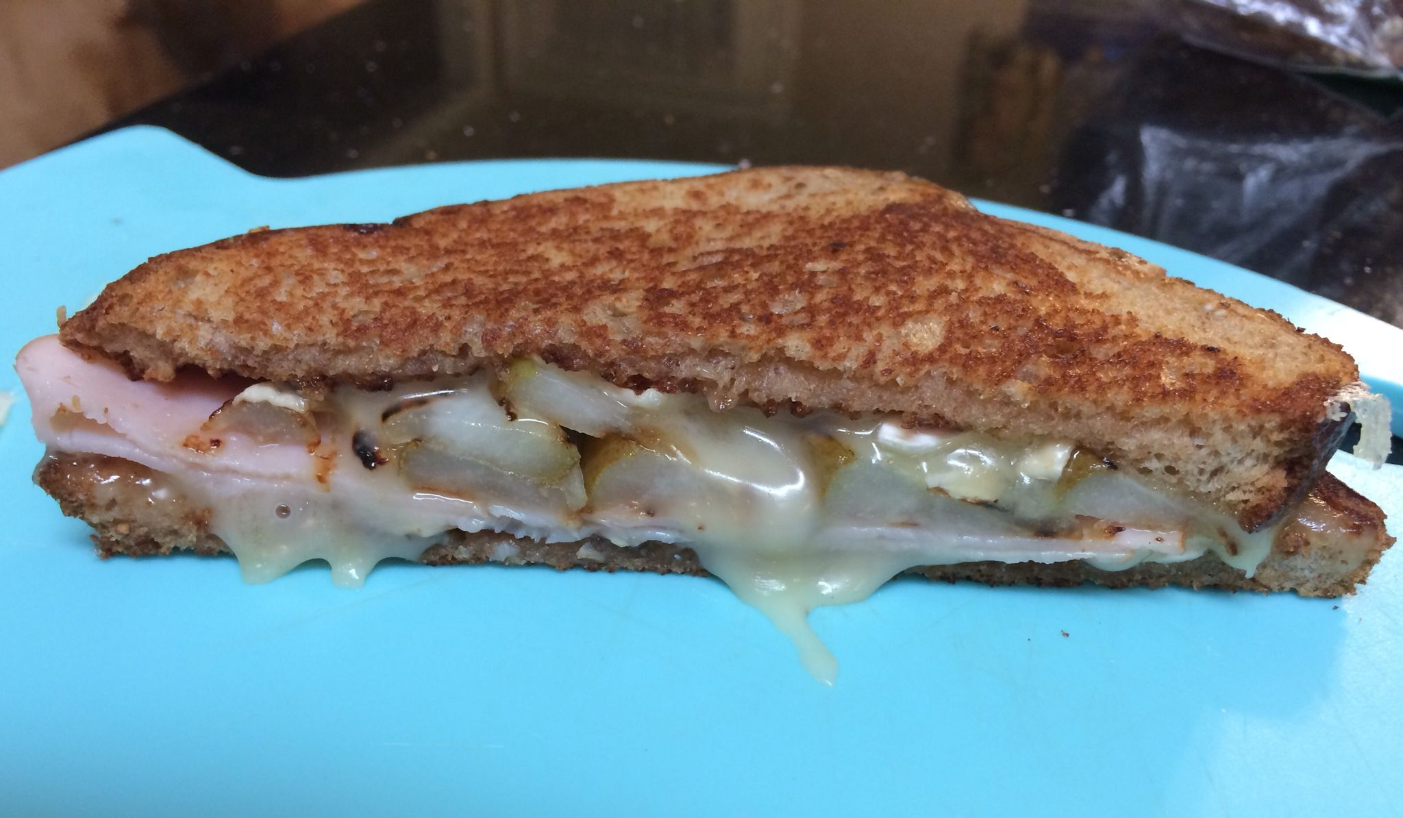 Grilled turkey, Brie and Grilled pear sandwich. It's like butter in your mouth!