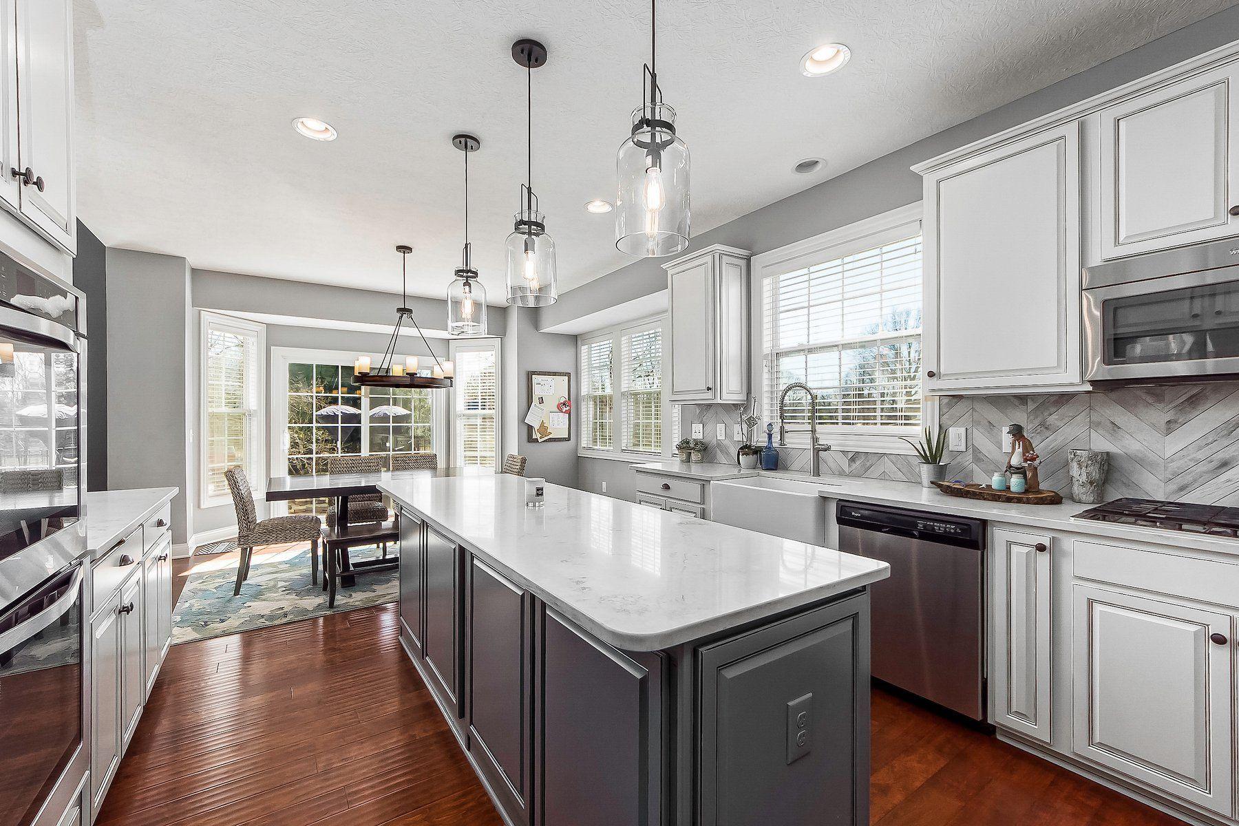 White Quartz Chevron Backsplash and Farmhouse Sink Kitchen Updates