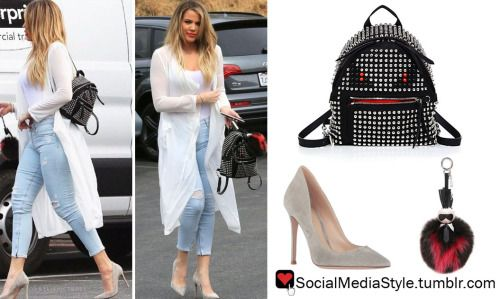 Buy Khloe Kardashian's Fendi Studded Monster Backpack and Fur Karl Lagerfeld Bag Charm and Gianvito Rossi Grey Suede Pumps, here!