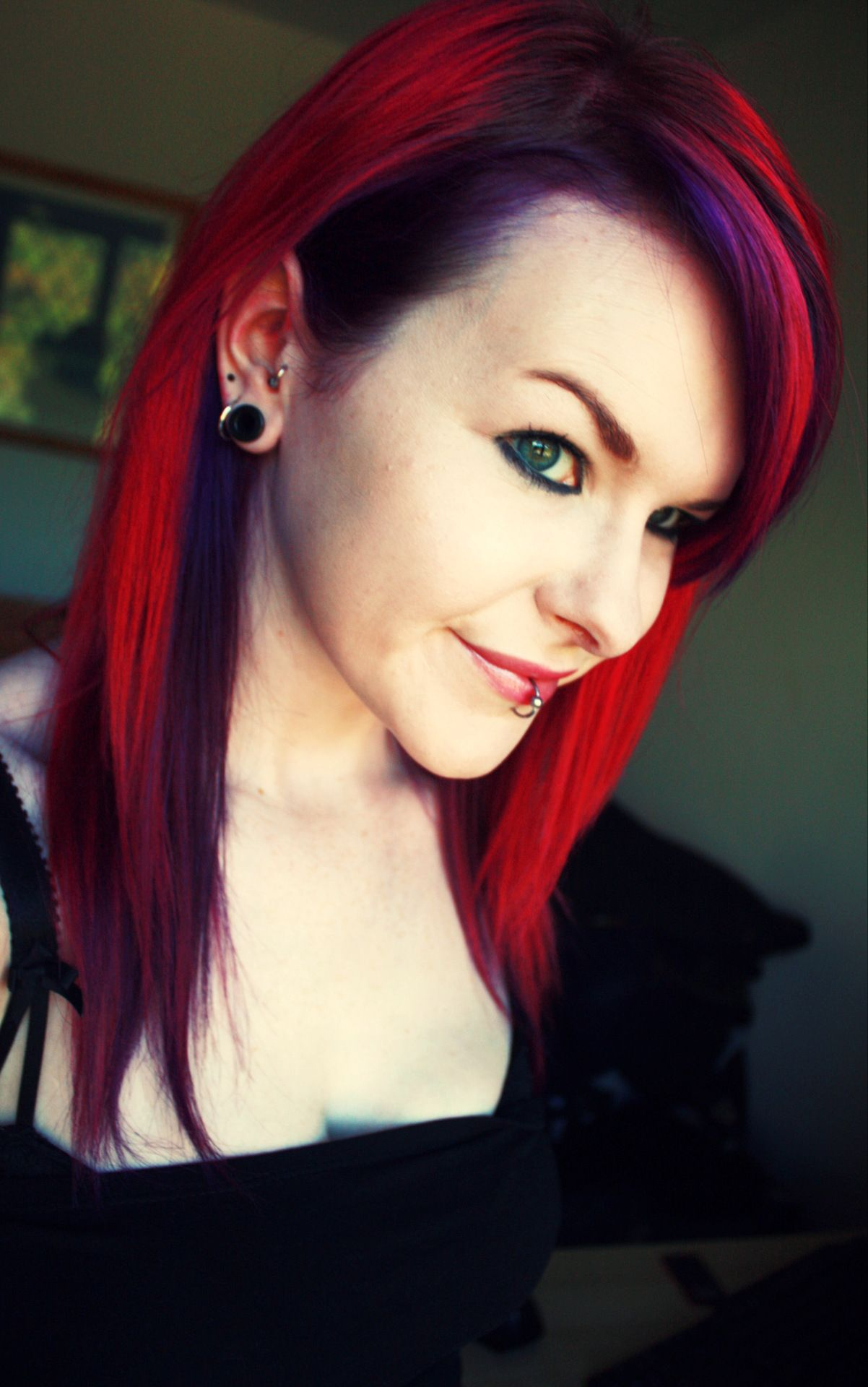 Red on top purple underneath via Not Your Typical Hair Blog