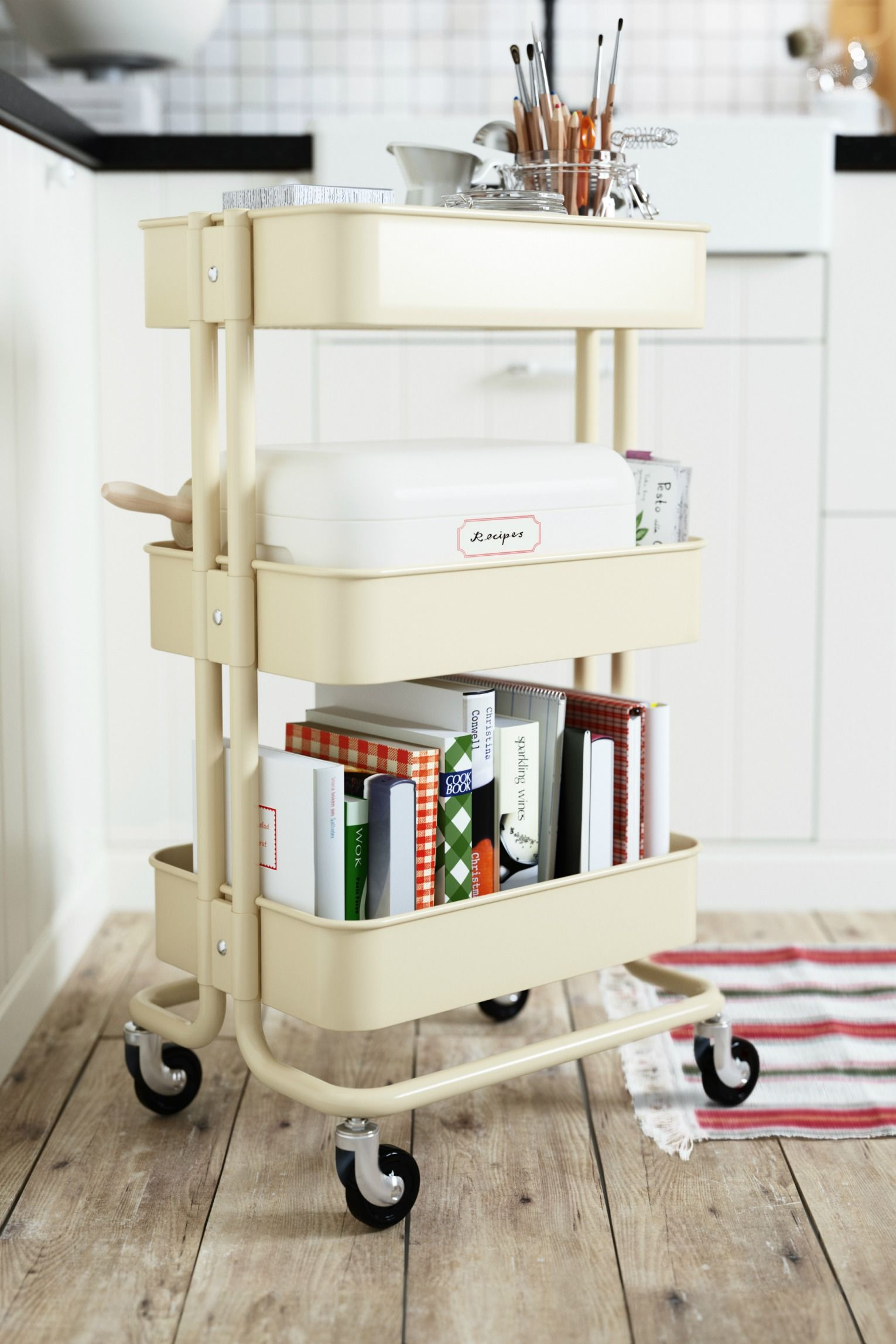 A cart with wheels like the IKEA R…SKOG utility cart provides great storage and