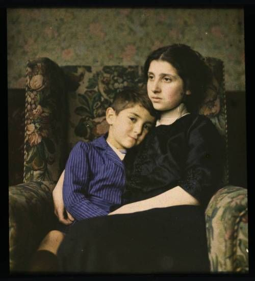 Woman and boy sitting in chair, 1915  -George Eastman Collection