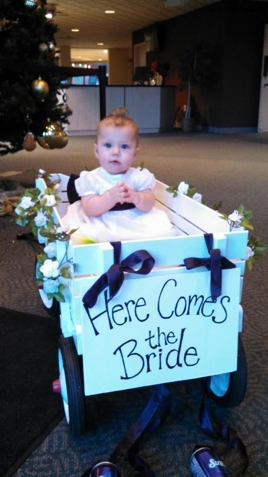 Wedding flower girl wagon...(my granddaughter) ...notice grape pop cans