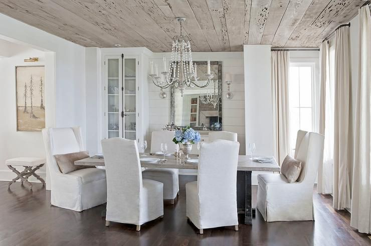 Classic Dining Room Features A Plank Ceiling Accented With Clear Beaded Chandelier Illuminating Gray