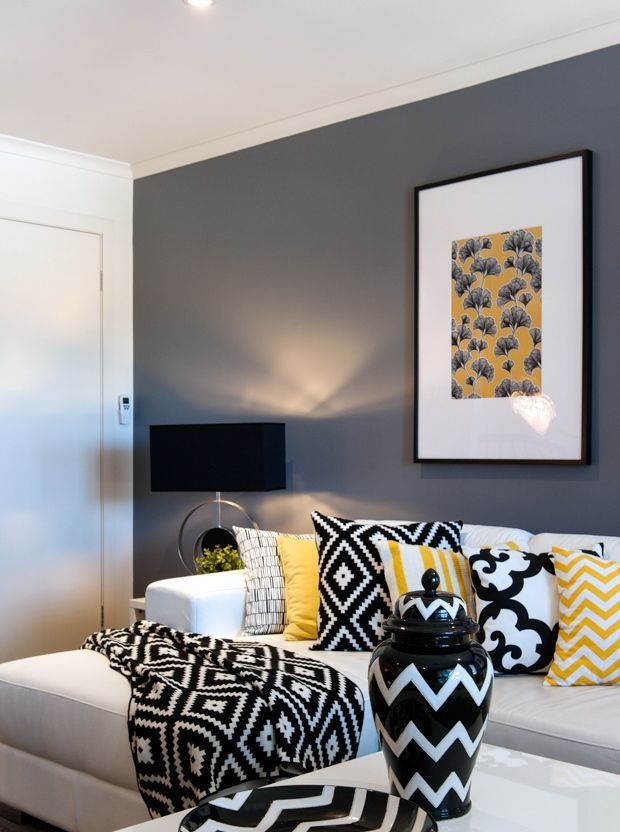 Black, Yellow, And White In Bold Patterns Make A Big Statement In This Living Room. We Love Th… | Living Room White, Grey And Yellow Living Room, Yellow Living Room