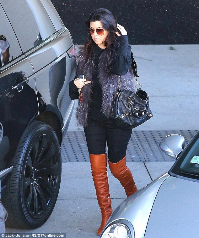 Kourtney Kardashian dons a fur gilet and thigh high boots in LA ...
