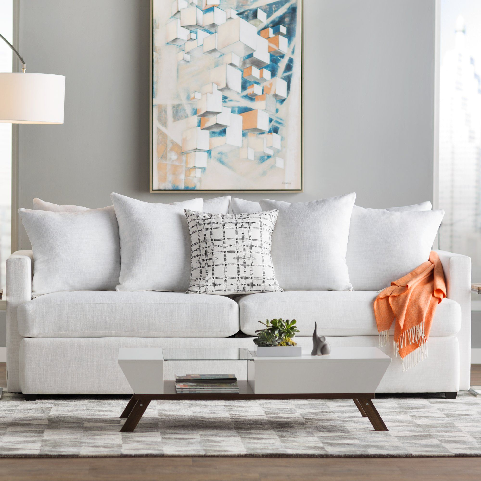 Anchor your parlor or living room ensemble with this understated