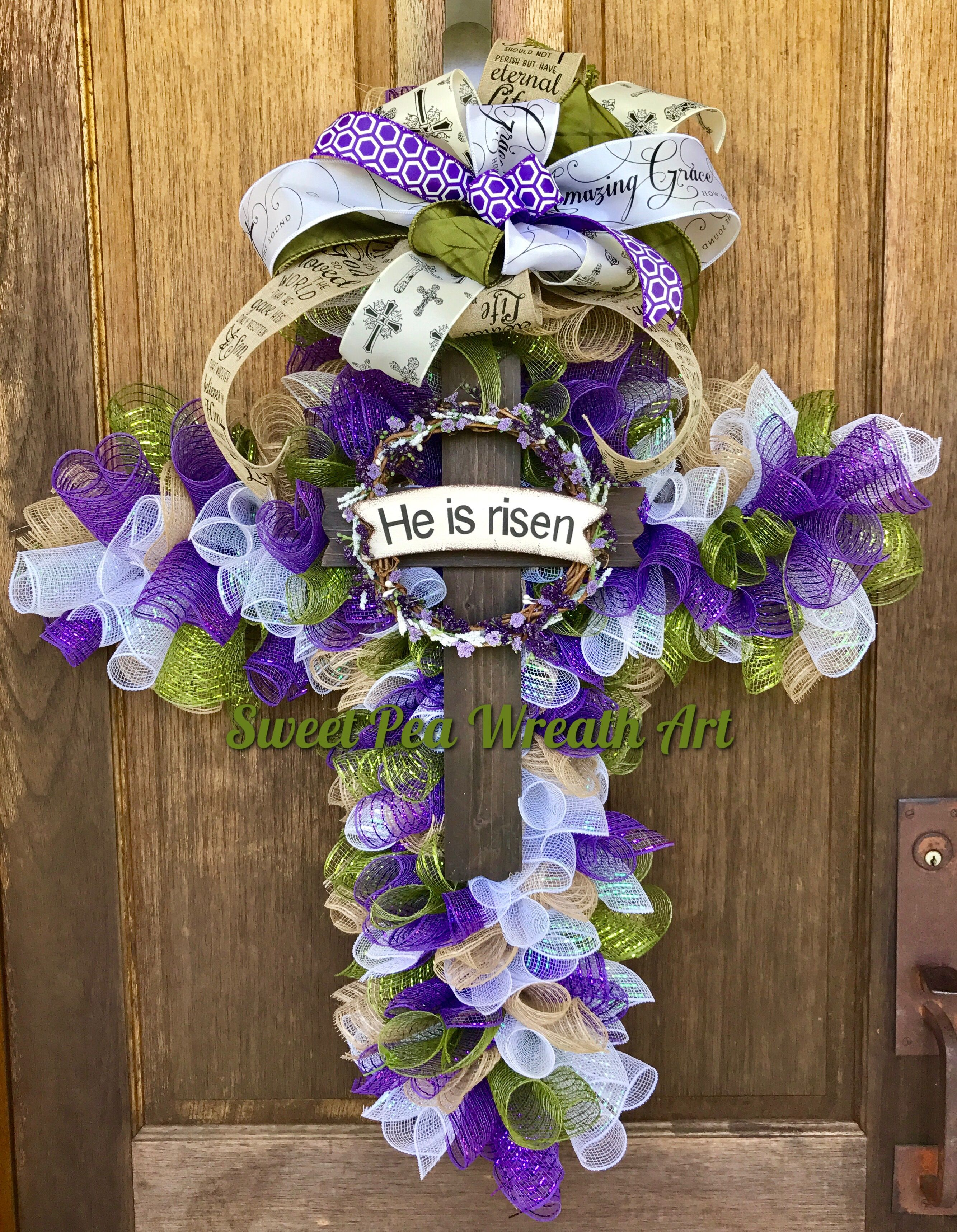 Beautifully reverent cross wreath in colors that remind us of the
