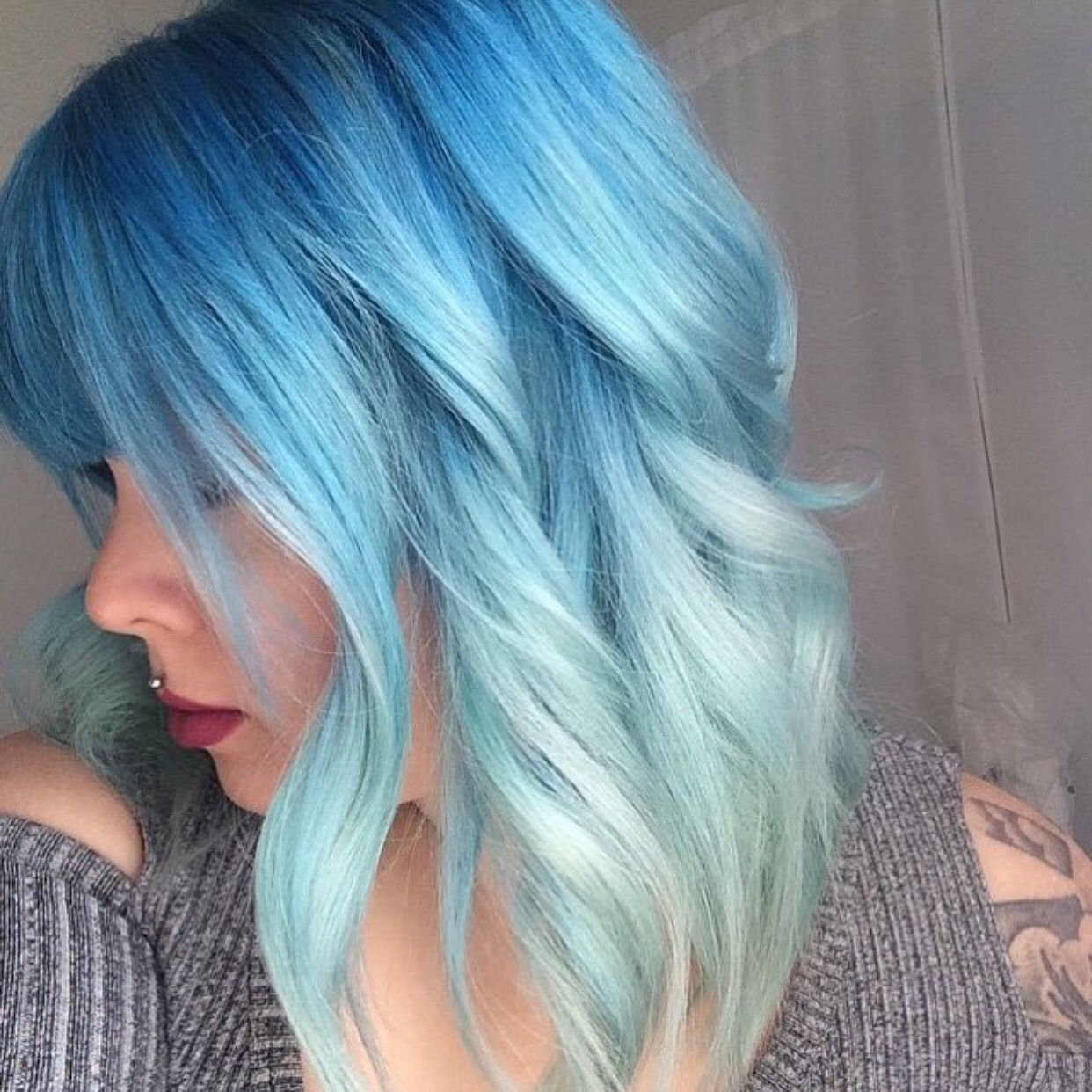 Blue hair color melt and beautiful curly lob by ashley rodgers
