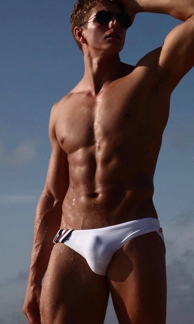 Hot VPL bulge in this beautiful toned guy s wet white Speedos More