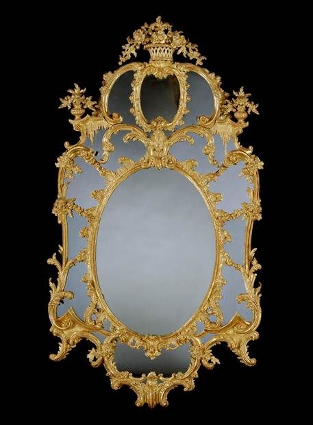 A GEORGE III GILTWOOD MIRROR A highly elaborate and most important mid 18th century Chippendale period carved giltwood border glass mirror in the manner of John Linnell