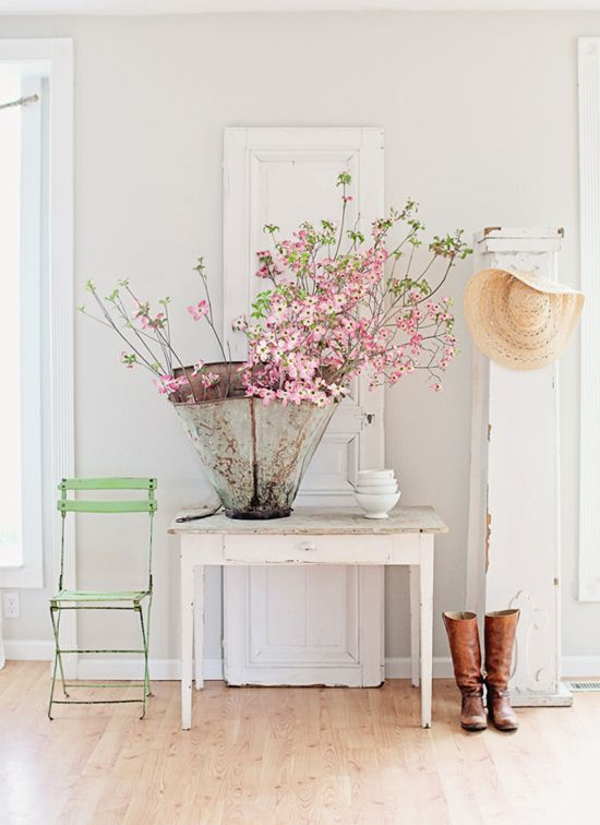 Floral branches in a bucket   At Home in Love