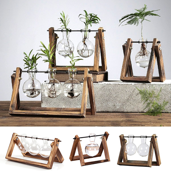 Plant Terrarium with Wooden Stand Welcome invigorating greenery in your home - it's stress-relieving and calming effect keeps you full of freshness and vitality. Place them in this rustic plant terrarium with an adorable wooden stand that serves as an exquisite sanctuary for them; making them look like picturesque trophies i