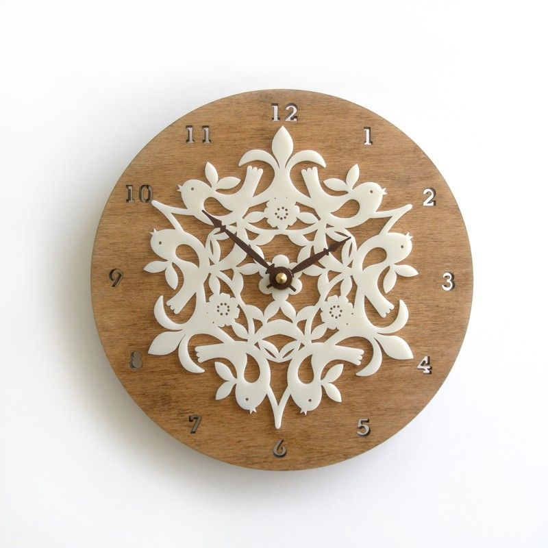 Kirie is a japanese word for paper cutting art. Kirie clock series explore design motifs based on this traditional paper cutting art with laser cut acrylics. eco-friendly 3ply bamboo  -it's lovingly sanded and finished with natural oil. -Intricately laser cut Acrylic Ivory -Chocolate brown hour and minute hands.