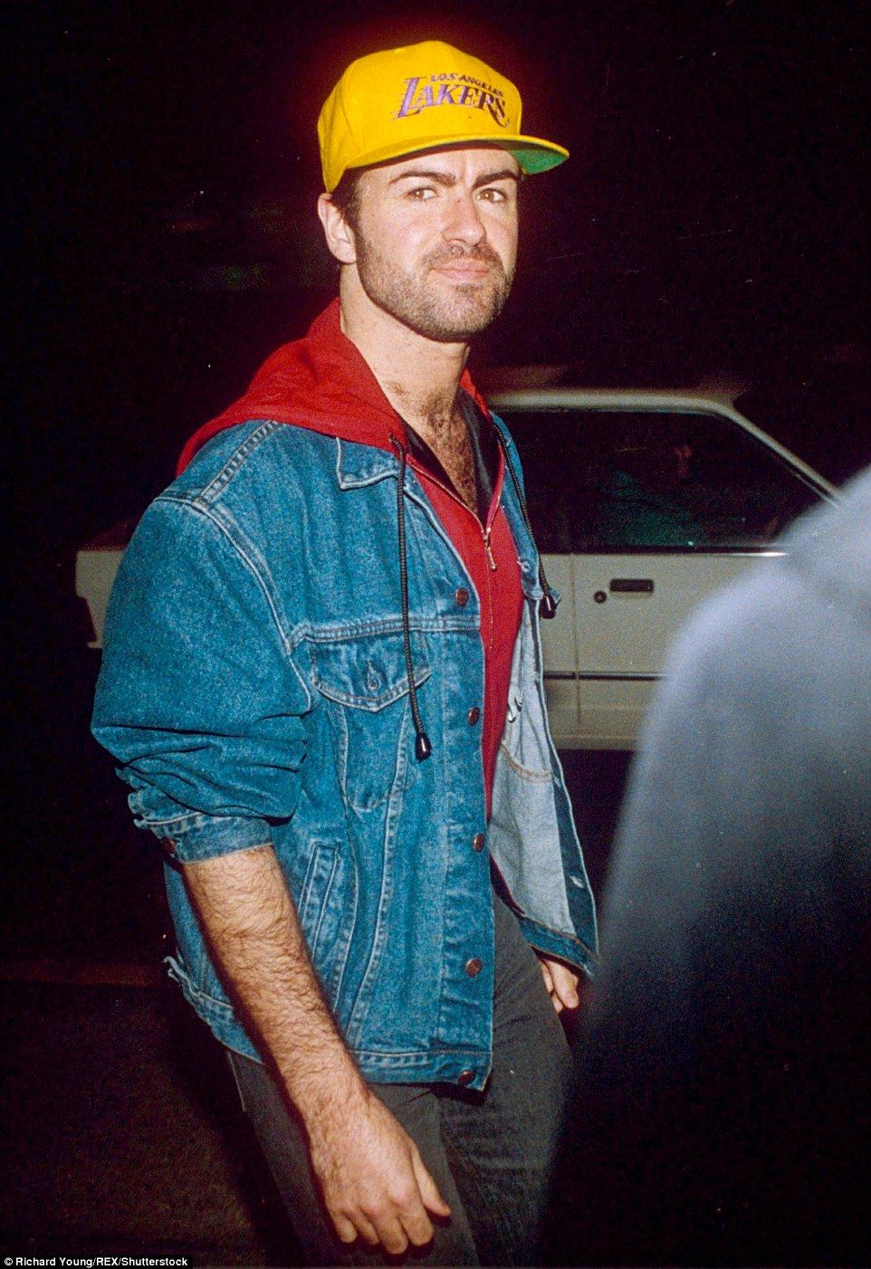 George Michael was wearing a Los Angeles Lakers baseball hat when he  attended a party for the War of the Roses film in London in 1990 1b9c6687ccf