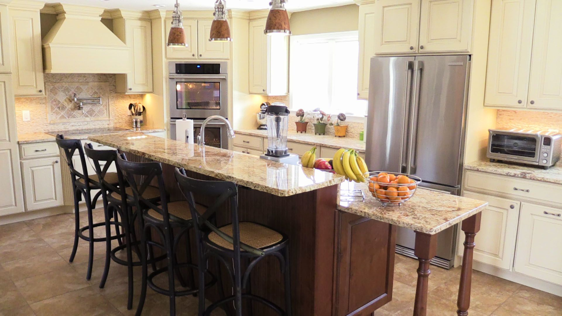 Beige cabinets with granite counters and hazelnut brown island