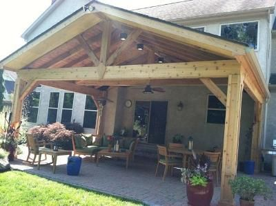 the open gable detail adds charm to this covered patio in columbus
