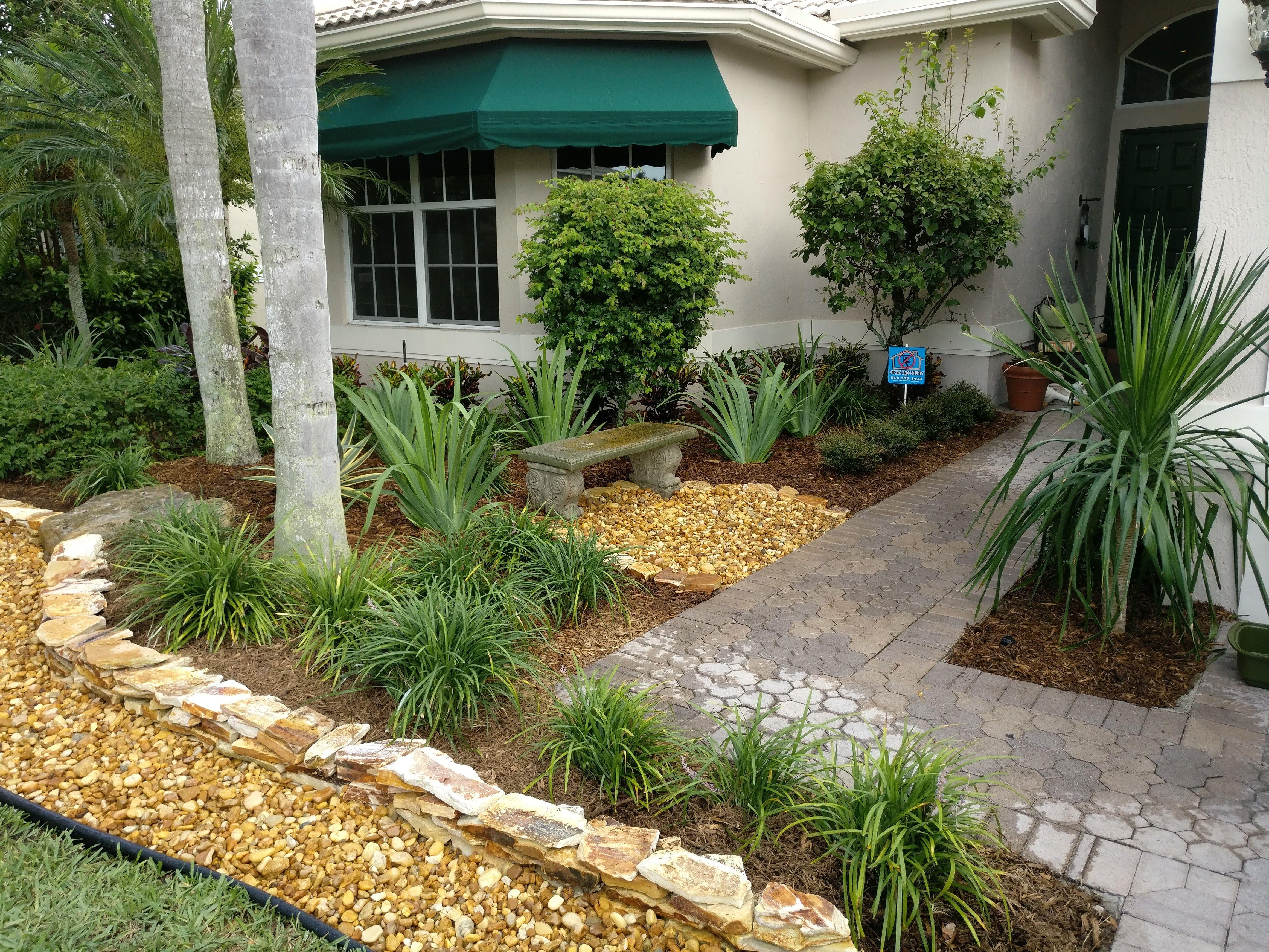 Landscape refurbishment using stones and tropicals.