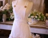 Vintage Inspired Fashion Apron -Sexy Linen Peaches and Cream Tiered Apron. $139.00, via Etsy.