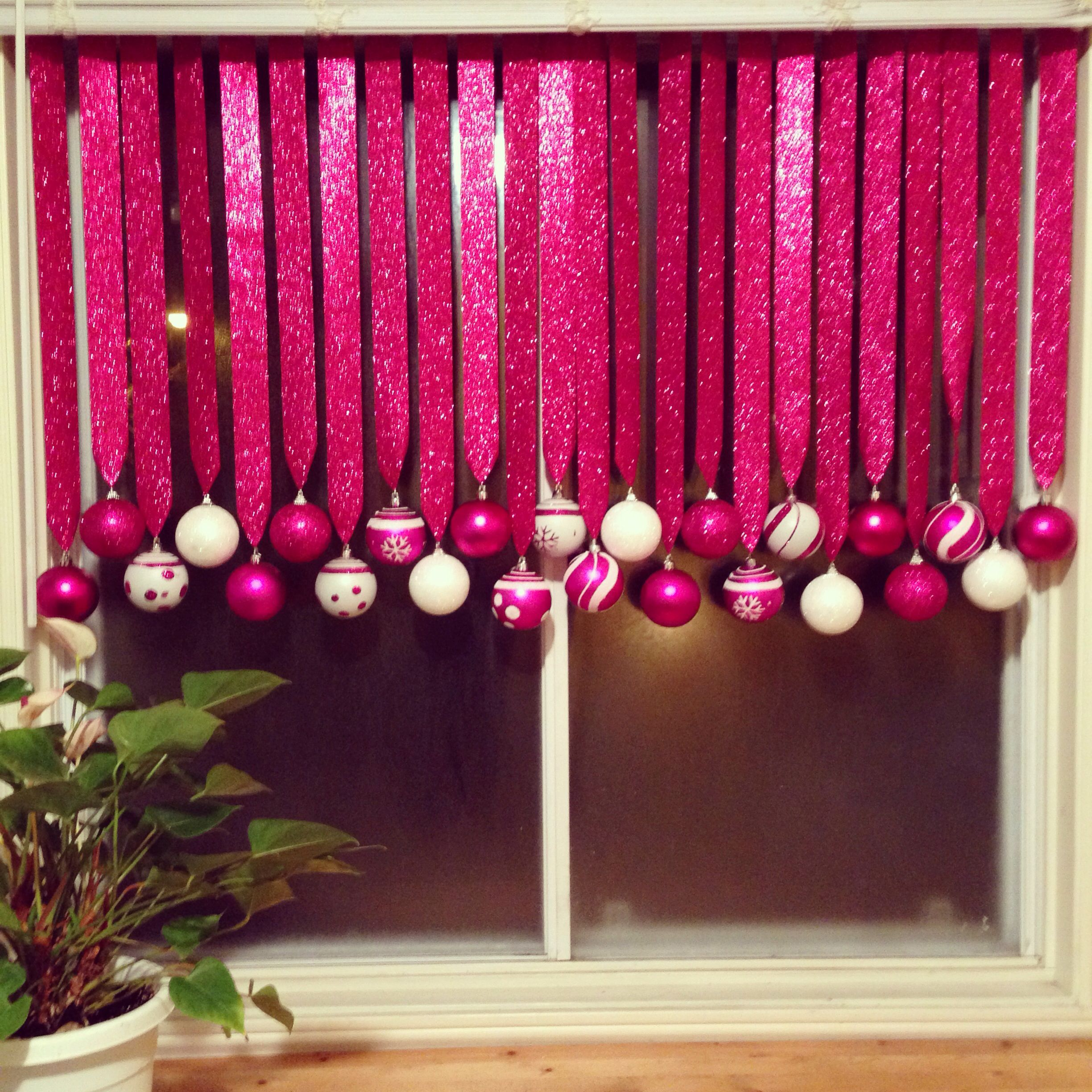 Easy Christmas Decorations Hang ornaments from ribbon in windowsill
