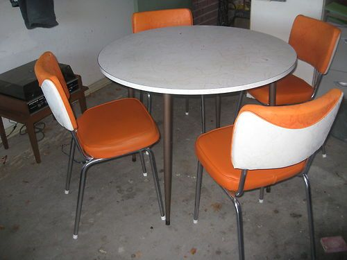 Round table with 4 white & orange chairs
