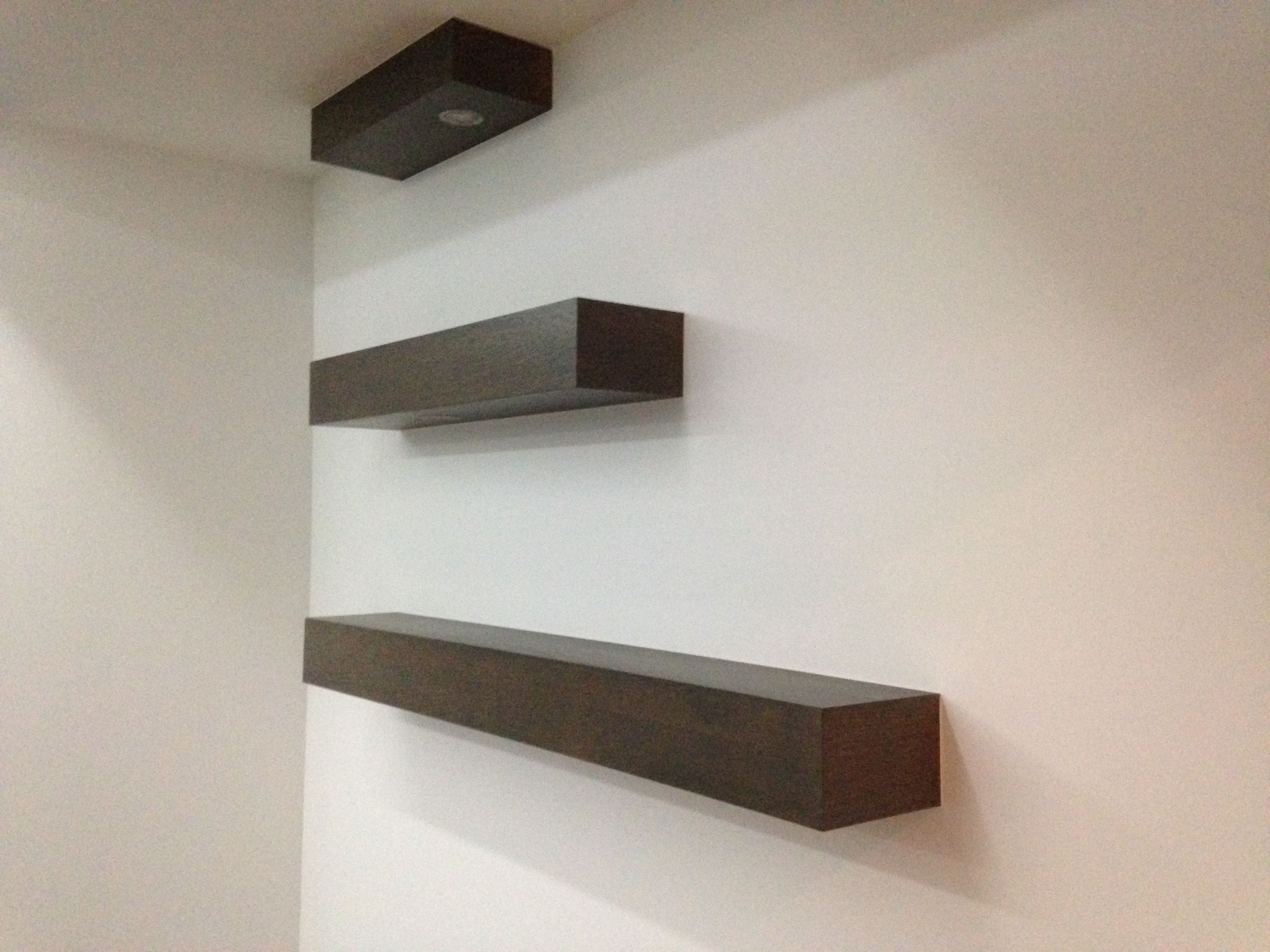 floating shelves made out of plywood around 2x4 s nailed to the