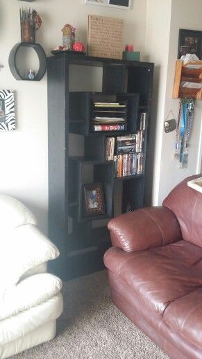 Organize the living room with a simple shelf...