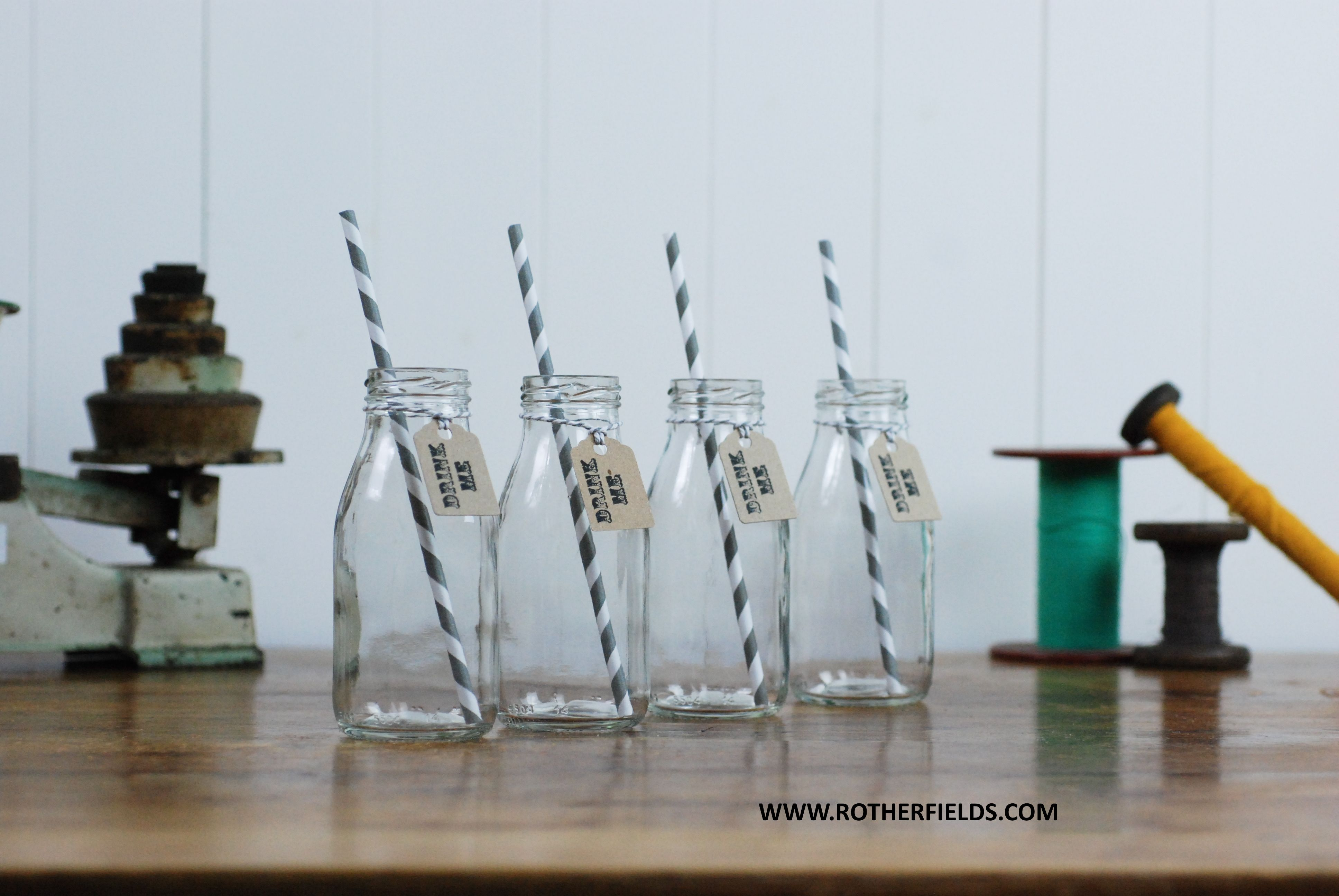 Mini milk bottles including paper straws & tags - perfect for weddings, parties & events. Great for vintage / retro style Cocktails!  Purchase set of 4 from WWW.ROTHERFIELDS.COM for £9.99